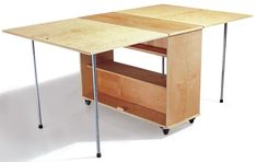 to Build a Compact Folding Workbench with Storage DIY - Folding Workbench can make into a craft room table with hidden storage. Fold up and roll out of the way when not in use.Storage Storage may refer to: Workbench With Storage, Folding Workbench, Workbench Plans, Workbench Organization, Garage Workbench, Workbench Designs, Workbench Table, Industrial Workbench, Portable Workbench