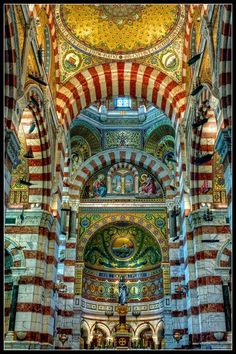 Notre-Dame de la Garde (Our Lady of the Guard), is a Catholic basilica in Marseille, France.  By Arnaud D...