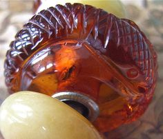 Carved amber snake bead with insect. Crystals Minerals, Rocks And Minerals, Jewelry Art, Jewlery, Troll Beads, Amber Necklace, Jewelry Companies, Baltic Amber, Art Object