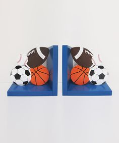 "Sweeten up décor with a touch of sporty style. With a darling design perfect for adorable athletes in the making, this pair of bookends helps to prop up favorite picture books while adding a touch of classically cool charm to bedrooms and nurseries. Includes two bookends7"" W x 7"" HMedium-density fiberboard"