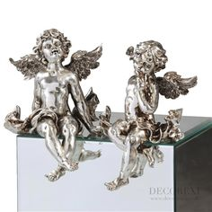 Large Pair Of Antique Silver Sitting Cherub Figures