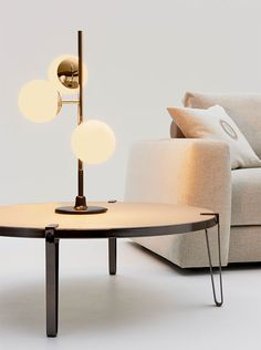 Trussardi Casa - Cherries table lamp and Bondai coffee table www.luxurylivinggroup.com #Trussardi #LuxuryLivingGroup