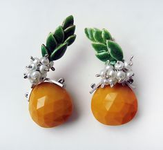 Fun pineapple earrings to be admired. Pineapples by Giselle Kolb available at www.artfulhome.com