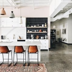 14 Reasons to Consider Dreamy Concrete Kitchen Floors - polished concrete kitchen floors in modern kitchen with area rug - Kitchen Shelf Decor, Boho Kitchen, Kitchen Rug, Kitchen Flooring, Kitchen Countertops, New Kitchen, Kitchen Backsplash, Studio Kitchen, Kitchen Modern
