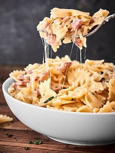 #ad This One Pot Ham and Cheese Pasta Recipe is the perfect way to use up that leftover holiday ham! A quick and easy recipe full of pasta, swiss cheese, and ham!showmetheyummy.com Made in partnership w/ @smithfieldfoods #HolidayHub