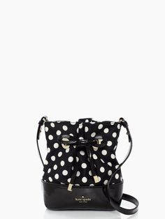 a dotted bucket bag