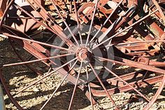 Old metal wheels on farm equipment long since antiquated.
