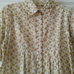 Cotton Blouse Peppy cotton botique blouse with circle pattern. Nice detail with delicate pleats and french cuffs /cufflinks. Extra button on interior placket. Very gently worn. White with olive - gold-tan -ish color! ninety Tops Blouses