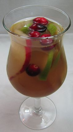 """Recipe for a """"winter white sangria"""" includes pears, apples, cranberries, nutmeg and cloves."""
