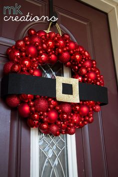 "DIY: Ornament WreathSupplies: Hobby Lobby  12"" styrofoam wreath  3"" red ribbon  gold rope [Christmas Sect]  hot glue  red ornaments, regular size  2 boxes tiny red ornaments  tiny red, foam balls"