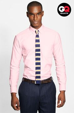 Brooks Brothers Oxford Shirt A slim spread collar tops a crisp cotton oxford sport shirt fronted by a single chest pocket and accented with contrast trim.