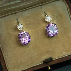 Rare Siberian amethysts are usually associated with deep royal purple, although it's not always the case. Here is a pair of antique Russian (fully hallmarked) earrings set with cushion cut Siberian amethysts of a brilliant light lavender purple color with splashes of pink, accented by old cushion cut diamonds. There is a huge demand for antique Russian amethyst jewelry. We've priced these spectacular earrings at $8,900 and expect to sell them fast. @romanov_russia.