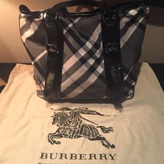 Burberry tote Authentic Burberry tote black, cream and charcoal plaid. Excellent condition comes with Burberry duster bag. No trades please Burberry Bags Totes