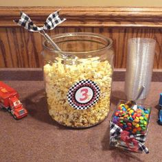 Race Car Party: Caleb's Disney Cars 3rd Birthday Party   Belly Feathers :: Handmade Party Ideas Blog by Betsy Pruitt: like popcorn in container with smaller cups next to it