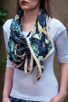 We adore the print on this Tropical Fruit Dark Scarf - with a cream pom pom trim. Made of silky cupro fabric by POM Amsterdam at the-Bias-Cut.com