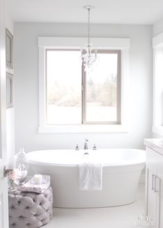 Tranquil Glam Master Bathroom Tour. Sharing our neutral and soothing oasis with a free-standing tub, crystal chandelier, and crystal sconces.