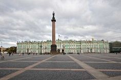 Alexander Column stands in the center of Palace Square, behind which looms the ornate Winter Palace, which today houses the Hermitage Museum