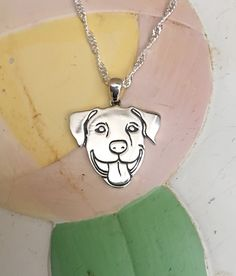 """Smiling Pit Bull Sterling Silver Necklace and Charm http://www.dogwithamustache.org/products/smiling-pit-bull-sterling-silver-necklace-and-charm Commissioned by Dog With A Mustache, this one-of-a-kind .925 sterling silver Smiling Pit Bull charm hangs beautifully on your choice of a 16"""" or 18"""" sterling silver necklace."""