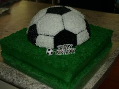 Soccer Birthday Cake - Bottom tier is choc sponge, ball is vanilla sponge. Made this for a boy's 9th birthday party.