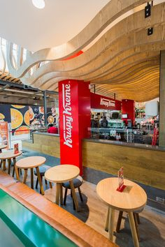 The contrast of warm timber elements and the prominent red cladding speaks of an inviting yet spunky hospitable space.  #Design #InteriorDesign #HospitalityDesign #SouthAfrica #Architecture #DesignThatWorks #DesignforEveryone #foodandbeverage #ExperienceDesign #DesignPartnership #RestaurantDesign #DesignPhotography #DesignInspiration #ConceptualDesign