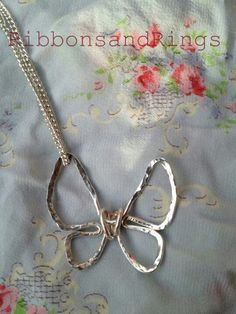 Beautiful silver plated hammered wire butterfly necklace facebook.com/ribbonsandrings