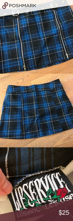 "Vintage NWOT Lip Service Punk Plaid Skirt Vintage NWOT LIP SERVICE Skirt! I purchased this skirt many years ago and I never wore it. The skirt is hot! Would be a great addition to any goth, punk, cosplay wardrobe! Skirt is a beautiful bright blue and black plaid with a small amount of white. It has functional zippers and buckles. Unfortunately due to age, the leatherette on the buckles has ""aged"" a bit.... it's completely unnoticeable unless you get up close and inspect it. NWOT. Juniors 7…"