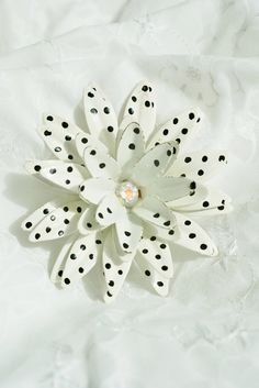 Vintage enamel white with black polka dots flower brooch pin with rhinestone middle on Etsy, $19.95