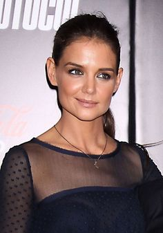 Katie Holmes sleek and sophisticated ponytail.  She's no cream puff.  You go girl!