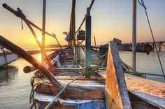 fishing boat at sunset HDR