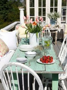 Table idea for the front deck, including the bow-back chairs.