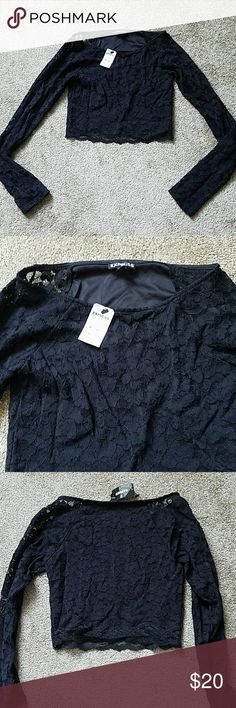NWT Express lace crop top Size extra small lace black crop top. See through lace sleeves. Super cute and Great for a night out! Express Tops