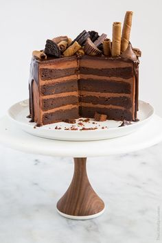 Death by Chocolate Cake. A dense and fudge-like chocolate cake with chocolate buttercream topped with dark chocolate ganache and decorated with all sorts of chocolates goodies.