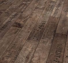 Floors made from old wine crates - The pattern was inspired by flooring found in old European cellars, which were often made of wood from discarded wine crates with fired-on inscriptions and dates.