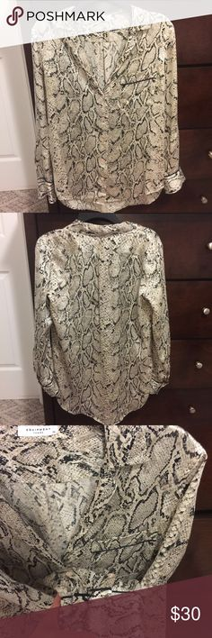 """Equipment silk shirt Fun silky snakeskin print can be dressed up or down. This button down definitely adds interest to any outfit! It's tunic length and looks amazing with leggings or jeggings (I'm 5'9).  Size """"extra small"""" but fits like a small, so that's where I listed it😘✌🏻  All my items are from a smoke free home.  I love to give BUNDLE discounts❣️ Just ask❣️ Equipment Tops Blouses"""