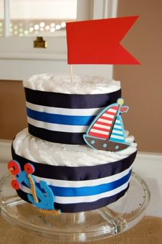 The caption said diaper cake, i guess those are diapers - cute baby shower idea.  But I can see how I could turn this into a welcome home cake :)