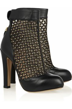 Booties are always modern and chic—especially with pretty lace or pattern stockings to add a little texture and whimsy.  Valentino|Studded leather and mesh ankle boots