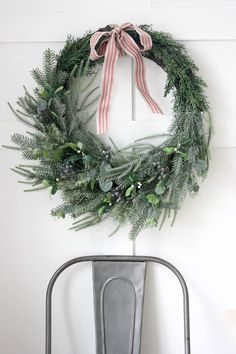 green wreath with metal chair