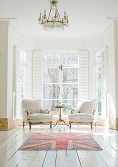 windows & shutters + simple, uncluttered design - curved legs on chairs and table add contrast to all the straight lines