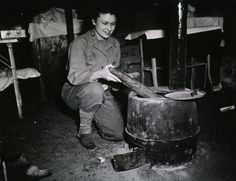 Army Nurse Lt. Helen Flippe in an army hospital tent in her HBT-outfit ~