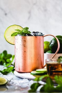 twist on a the classic Moscow Mule. This Kentucky Mule is made with bourbon, ginger beer, and lime. It is a perfect American mule drink for any occasion. Ginger Cocktails, Vodka Drinks, Summer Cocktails, Cocktail Drinks, Yummy Drinks, Cocktail Recipes, Alcoholic Drinks, Drinks With Ginger Beer, Campari Cocktails