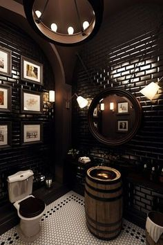 Basement bathroom. Black subway tile could be cool reverse of upstairs white subway tile. Barrel sink is cool touch.