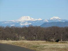 Snow covered Lassen Peak. On the right is Brokeoff peak, the remnant of ancient Mt. Tehama, the volcanic  precursor to Lassen Peak
