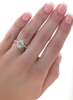 Pear Shaped Halo Diamond Ring ♥ ohh emmm geeee. so unique and beautiful!
