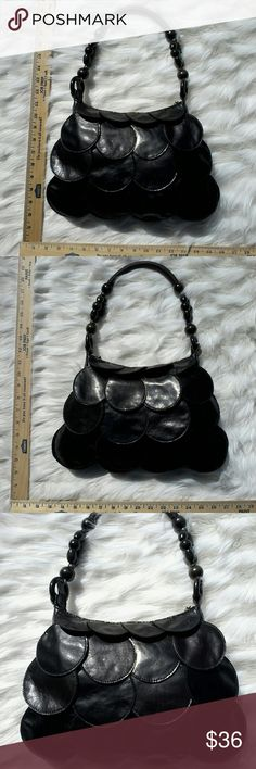 60s SPY CHIC NO NAME PURSE This is a super fun 1960s style purse with a hint of that bond girl style! This fun purse is constructed with overlapping circles, a strap with dark wooden green beads, & finger ring zipper. Just add some big round white or black glasses and your ready to take on the world! None Bags Totes
