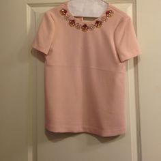 kate spade jeweled blouse This top has been worn 1 time. It's perfect for a night out or even just to dress up some jeans. It's a pale pink with a pretty jeweled neckline. kate spade Tops Blouses