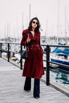 burgundy coat with lace up top and flared pants