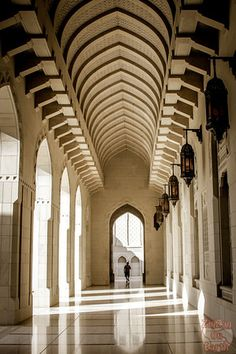 Corridor at the Sultan Qaboos Grand Mosque -  Discover 35 photos that will make you want to travel to the Sultanate of Oman: architecture, history, wildlife, landscapes... Get inspired at: http://www.zigzagonearth.com/oman-photos/