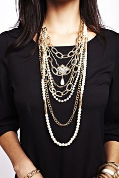 Make your own statement necklace by layering chains, pearls and an icon necklace. #littleblackdress