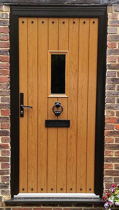 We blend specialist knowledge with the finest materials and craftsmanship to realise the ultimate next generation bespoke timber and wood effect uPVC windows and doors Cottage Style Doors, Cottage Door, Oak Doors, Wooden Doors, Oak Front Door, Upvc Windows, Wooden Door Design, External Doors, House Front