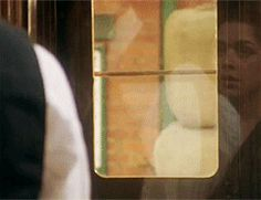 (gif) he saw her reflection in the train. Look at that smile! Stop being so cute!!